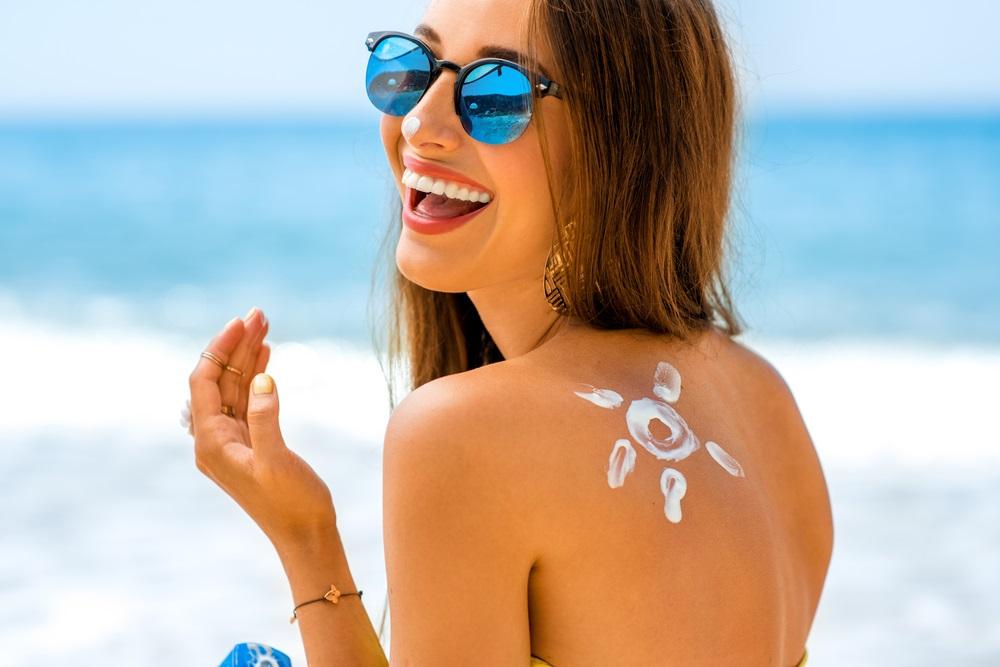 Girl Applying Suncream | Sun Protection